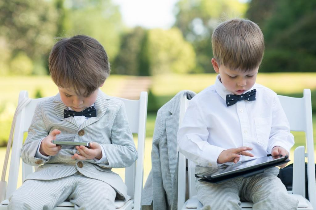 "OUT-OF-OFFICE: ""We really wanted all of our guests to feel as though they were on vacation,"" says D'Anne. Relaxed in their dapper seersucker suits, tech-savvy ring bearers Liam Green and Keenan Ward had no problem following their Aunt's request, plugging in some playtime before the ceremony."
