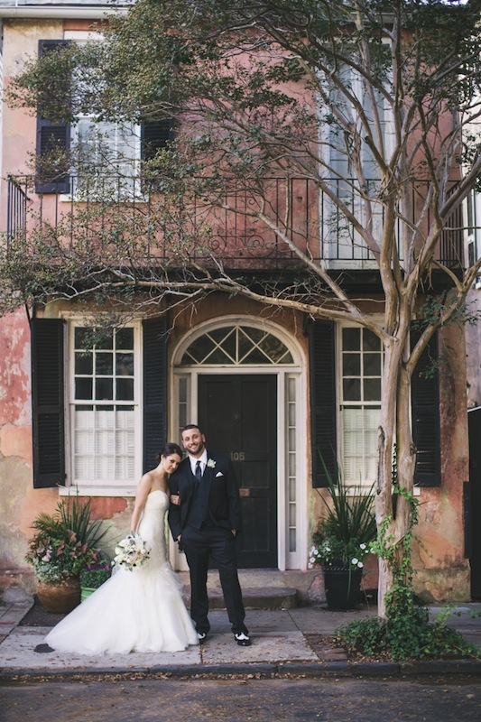 Bridal gown by Marisa, available in Charleston through Bridal House of Charleston. Groom's attire by Vera Wang from Men's Warehouse. Florals by Branch Design Studio. Photograph by Hyer Images.