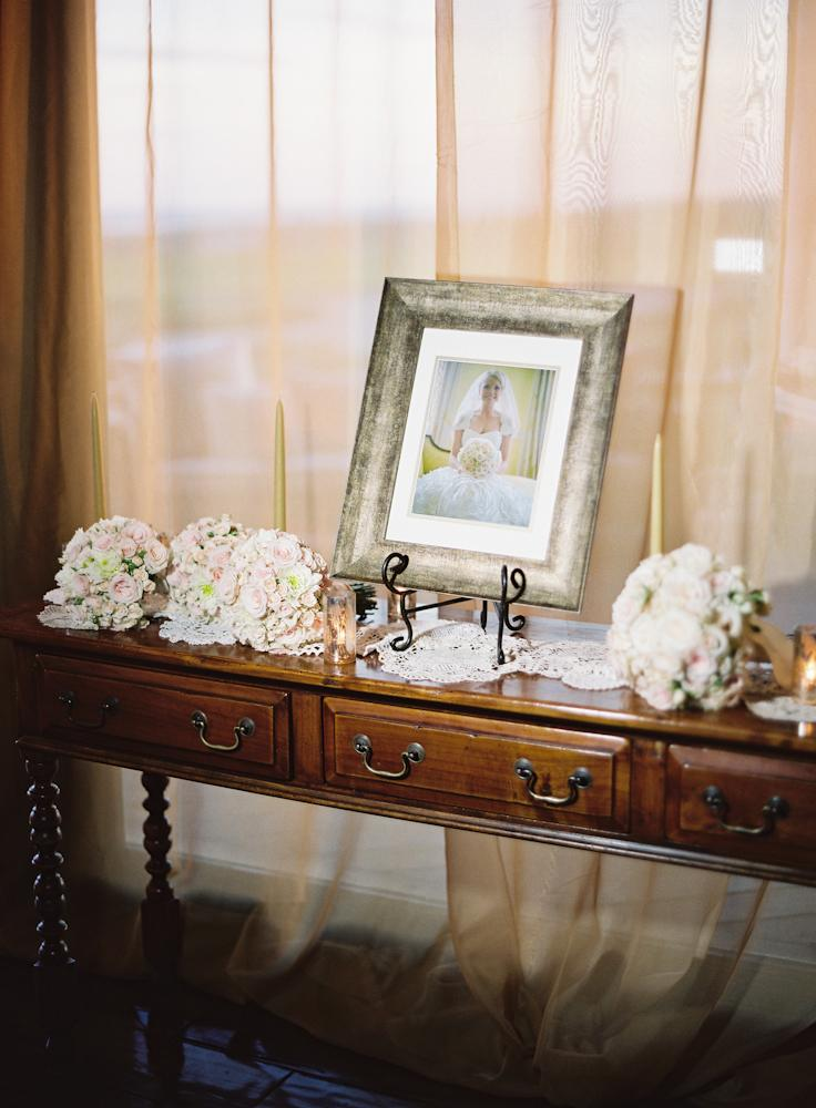 BUSY BEE: Crystal took on the project of finding classic antique frames to display each photo.