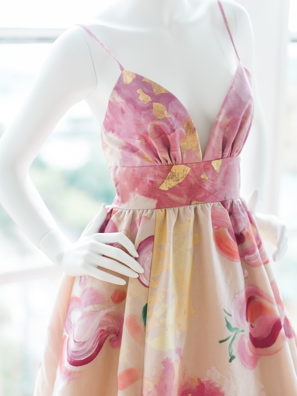 As market proved, color is the new white, and this bridal gown by Katherine Mullins McDonald shares that sentiment in soft hues of pink, gold, and citrus, along with another trend: pattern. The designer (known for her LulaKate brand) debuted her new spinoff line of bridal frocks, Kate McDonald, at the party.