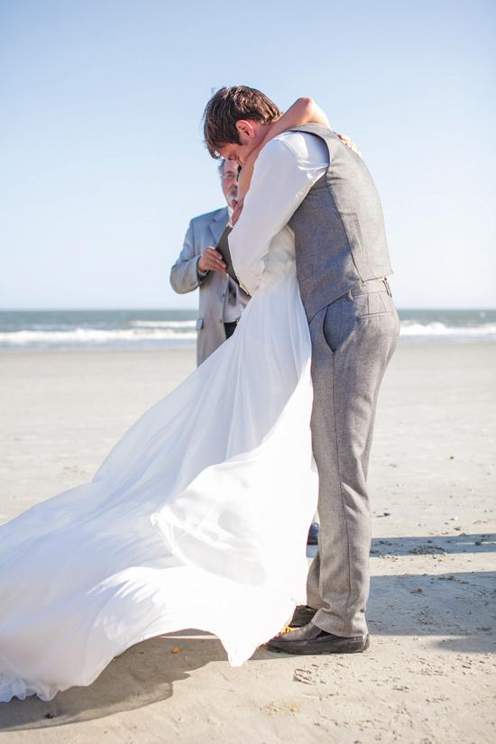"BLOWING IN THE WIND: Sara and Josh said ""I do"" with the idyllic Folly Beach for a backdrop. Sara's grandfather, who was a minster, delivered a very special blessing to the couple during the ceremony."
