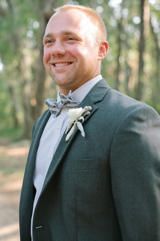 Groom's attire by Jos. A. Bank. Groom's bow tie by Banana Republic. Boutonniere by EM Creative Floral. Image by Ashley Seawell Photography.