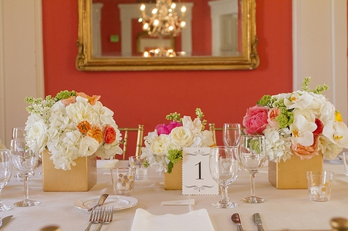 PALETTE PLAY: If your venue has bold walls—like the coral hue in the William Aiken House—keep the rest of the décor simple and tie it all together with the centerpieces.