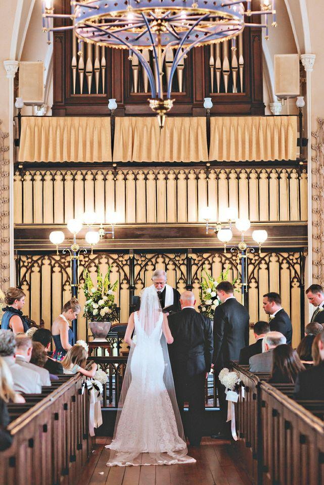 SET THE STAGE: Loluma accented The French Protestant (Huguenot) Church's deep wood décor with fresh white and green blooms.