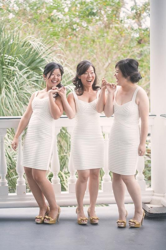 "Bridesmaids went for a fresh, modern look with snowy BCBGMAXAZRIA shorties and gold ""Sky Glitter"" sling-backs from shoemaker Melissa. Image by Virgil Bunao Photography at Lowndes Grove Plantation."