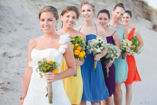 SISTERLY SUPPORT: Sara's 'maids—including her twin sister (in yellow) were a huge help with wedding preparation. Together, they created their own bouquets and did the rest of the wedding florals as well.