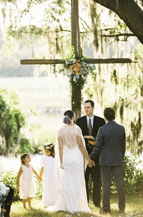SWEET THING: The couple's daughter watched intently as her parents wed on the banks of Horlbeck Creek.