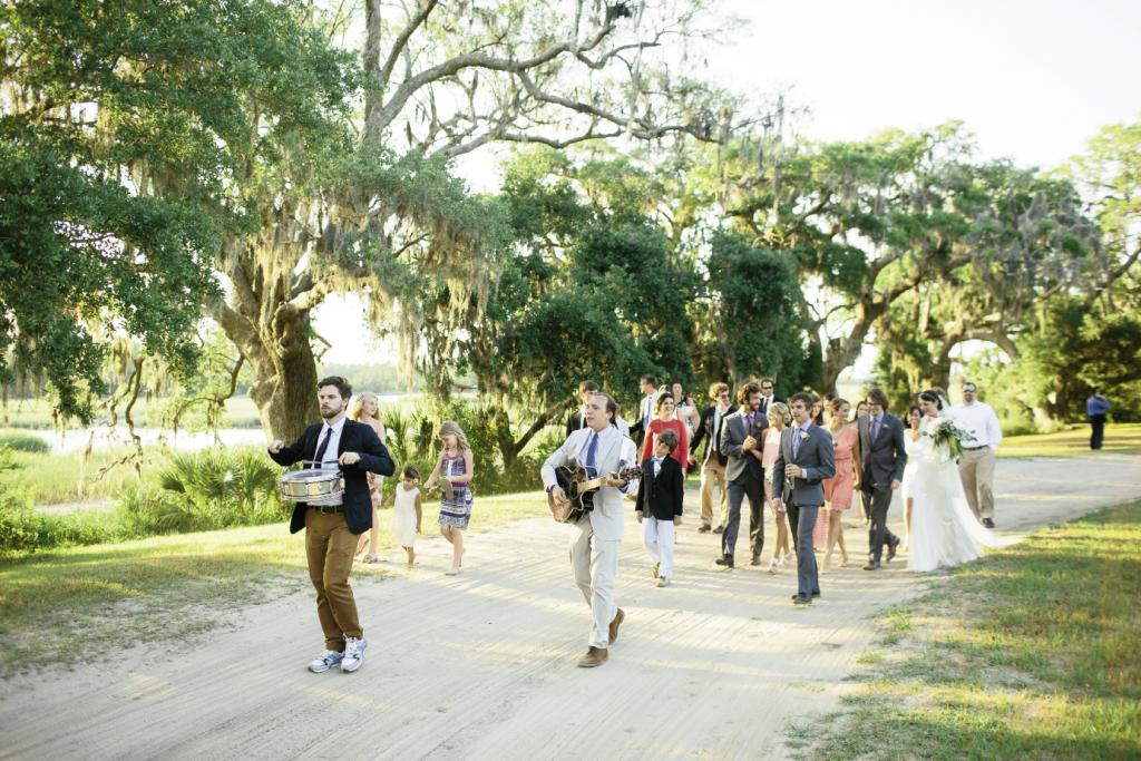 MARCH ON: Charles Carmody—director of Charleston Music Hall and a friend of the couple's—and Bennett MacNath led a parade from the ceremony site to the reception.