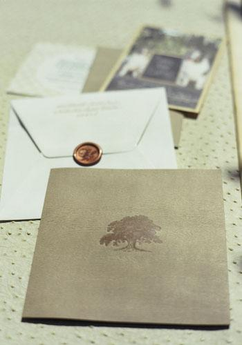 Stamp of Approval: Images of live oaks appeared on the invitations, programs, and etched glasses.