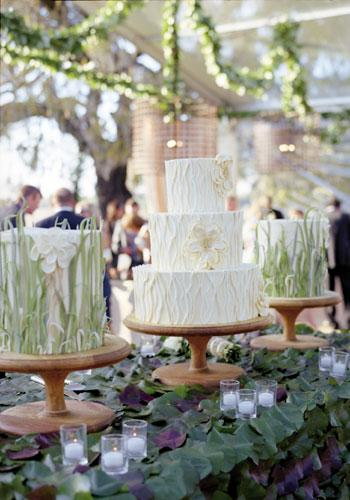 Tall Tiers: Wedding Cakes by Jim Smeal created three blooming confections flavored with chocolate, coconut, orange, and Triple Sec and iced in buttercream.