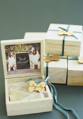 "Puppy Love: The couple's two beloved Australian shepherds inspired the ""doggie bag"" cake boxes which guests took home."