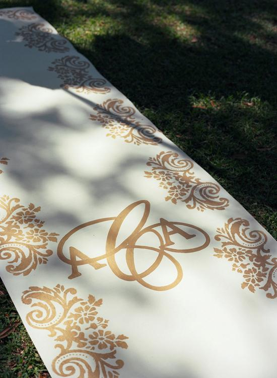 ROAD OF GOLD: The couple's monogrammed aisle runner was designed by Tara Guérard Soirée and crafted by Anne Melvin with Boutique Tents.