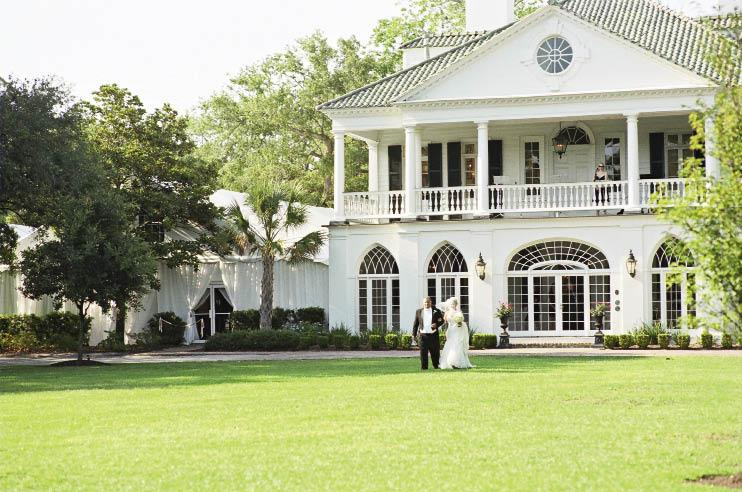 "EN PLEIN AIR: The couple chose Lowndes Grove Plantation for its ""beautiful and magical"" old oaks, says Ashley, pictured here with her father as they approached the ceremony."