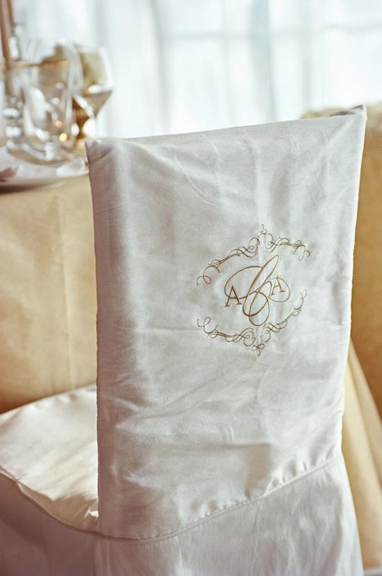MAKE A MARK: The bride and groom's dinner chairs were decorated with monogrammed seat covers.