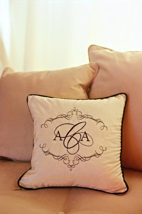 COMFY NAMESAKE: Pillows in the lounge area were marked the couple monogram, which was custom-designed by the Lettered Olive.