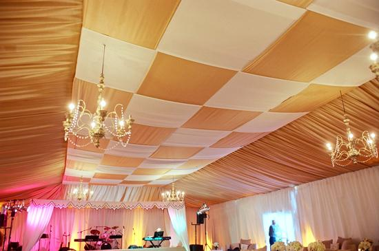 JAM BAND: Weaved gold and white fabric gave the ceiling of the dancing tent a rich yet spacious effect, while six-armed chandeliers and spotlights lit the large space.