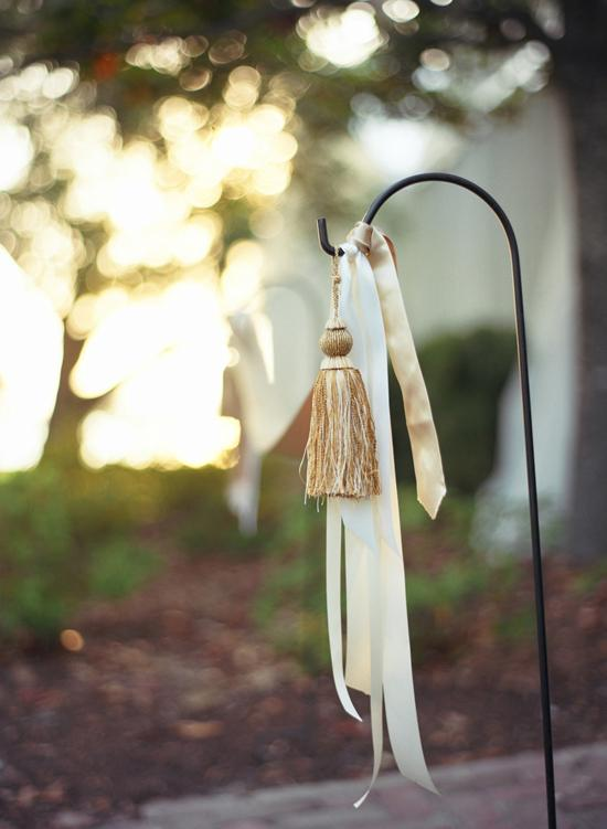 HANGING ADORNMENT: Soirée strung yard stakes with ribbons and tassels for a traditional touch that was more affordable than flowers.