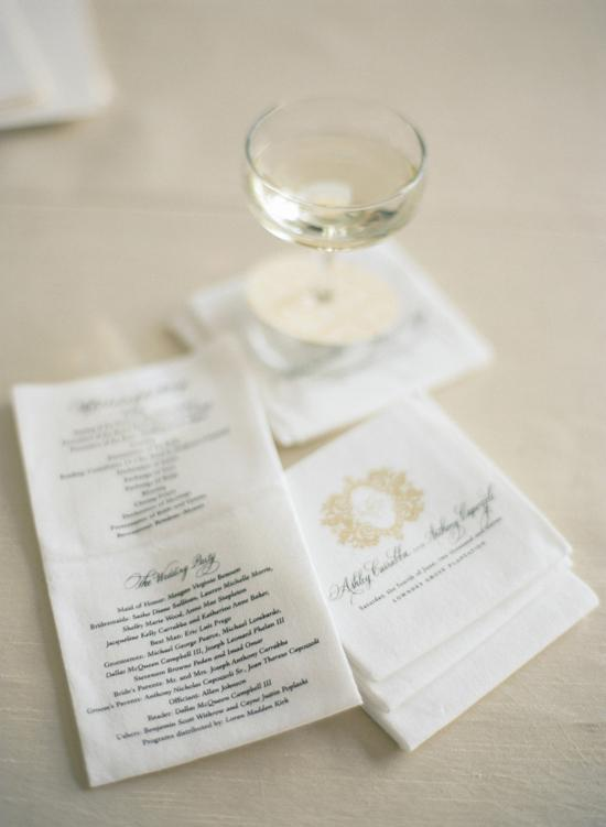 DUAL FOLD: Rather than distributing ceremony programs, the couple had the information printed on cocktail napkins for a money-saving touch. Guests were  given the napkins, along with a glass of champagne, upon arrival to the venue.