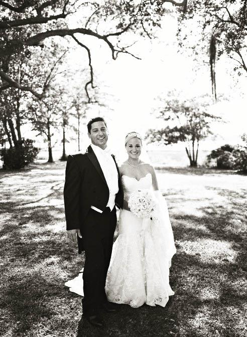 BLACK & WHITE: Ashley wore a Legends by Romona Keveza gown from Maddison Row while Tony suited up in black tails and a white bow tie from Grady Ervin & Co.