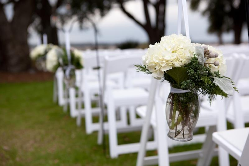 Florals by Tiger Lily Weddings. Rentals by Snyder Events and EventWorks. Image by Reese Moore Weddings at Lowndes Grove Plantation.