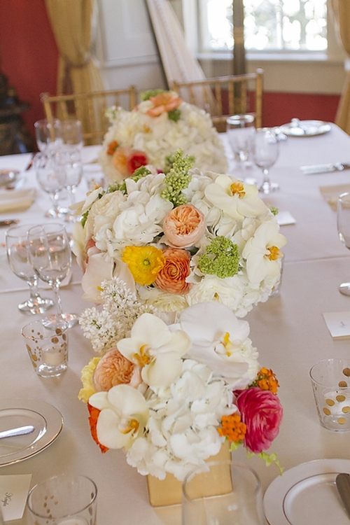 MIX & MATCH: Anne Dabney of stems dotted colorful blooms throughout larger white flowers like hydrangeas and orchids to keep from clashing with the coral walls.