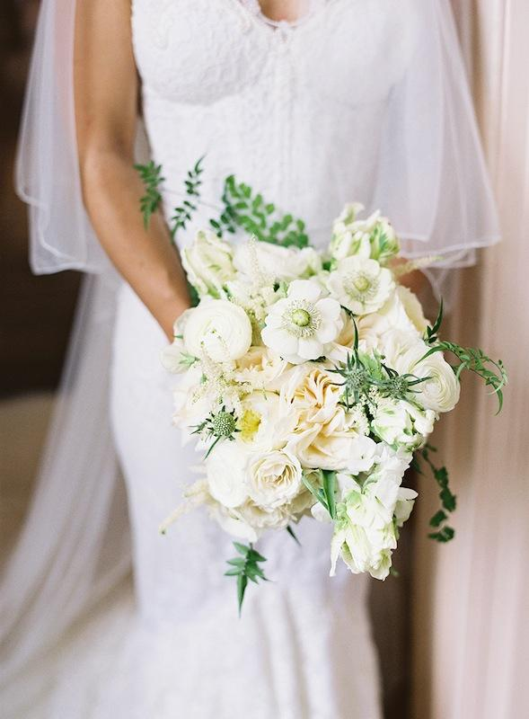 Bouquet by Sara York Grimshaw Designs. Bridal gown by Inbal Dror. Image by Virgil Bunao Photography at Lowndes Grove Plantation.