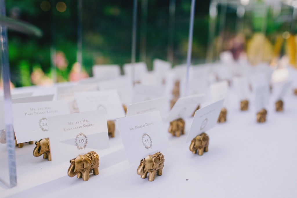 Planner Luke Wilson incorporated nods to Indian culture throughout décor, like these miniature elephants that held escort cards. <i>Photograph by Hyer Images</i>