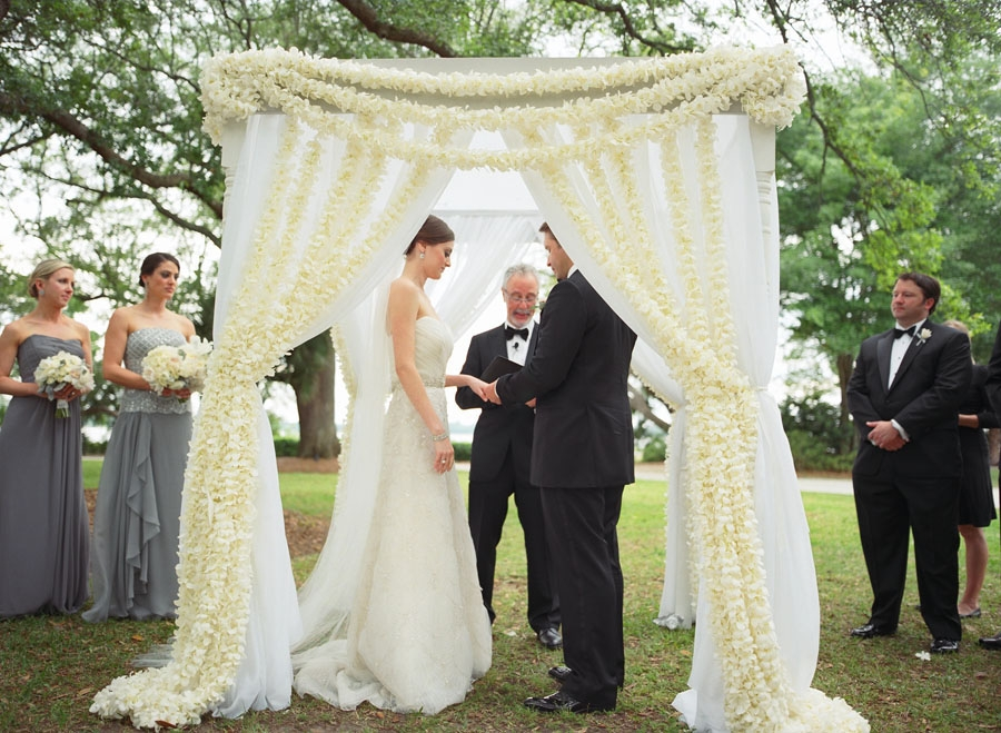 "WITH THIS RING: The couple exchanged vows beneath an altar of sheer fabric and fresh flower garlands. Sara's uncle officiated the ceremony. ""Even with no experience, we knew he would do an amazing job,"" says Sara."