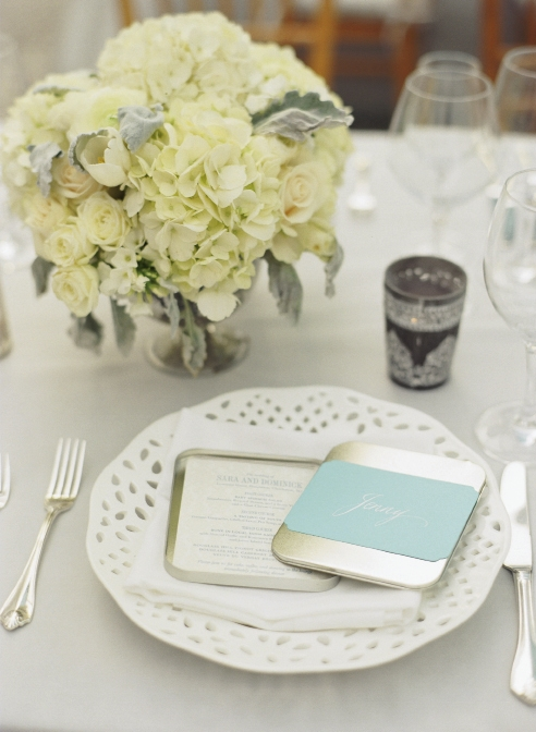 BAND TOGETHER: The Lettered Olive printed dinner menus on paper bearing a soft gray and white design. Blue bands with names calligraphed by Elizabeth Porcher Jones doubled as place cards.