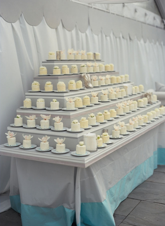 "SWEET SWEETS: The mini cakes by A Matter of Taste were topped with real flowers and arranged on a soft gray display. Says Sara of the dessert spread, ""I saw the idea in Vogue and thought it was adorable."""