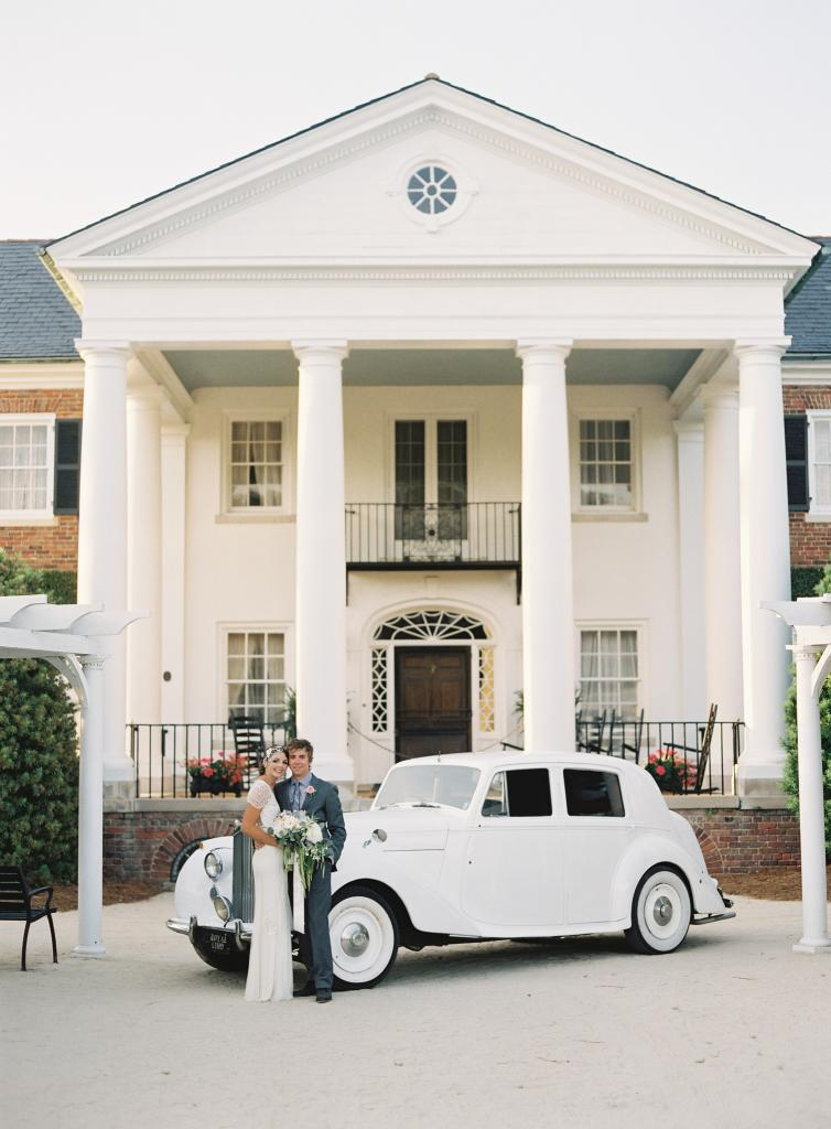 CLASSIC SURROUNDINGS: Boone Hall Plantation's stately exterior served as the perfect backdrop for this vintage-inspired wedding.