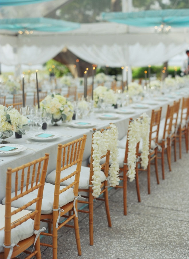 MAKE YOUR MARK: The bride and groom's reception seats were designated by strings of flowers—the same garlands that adorned the ceremony's altar.