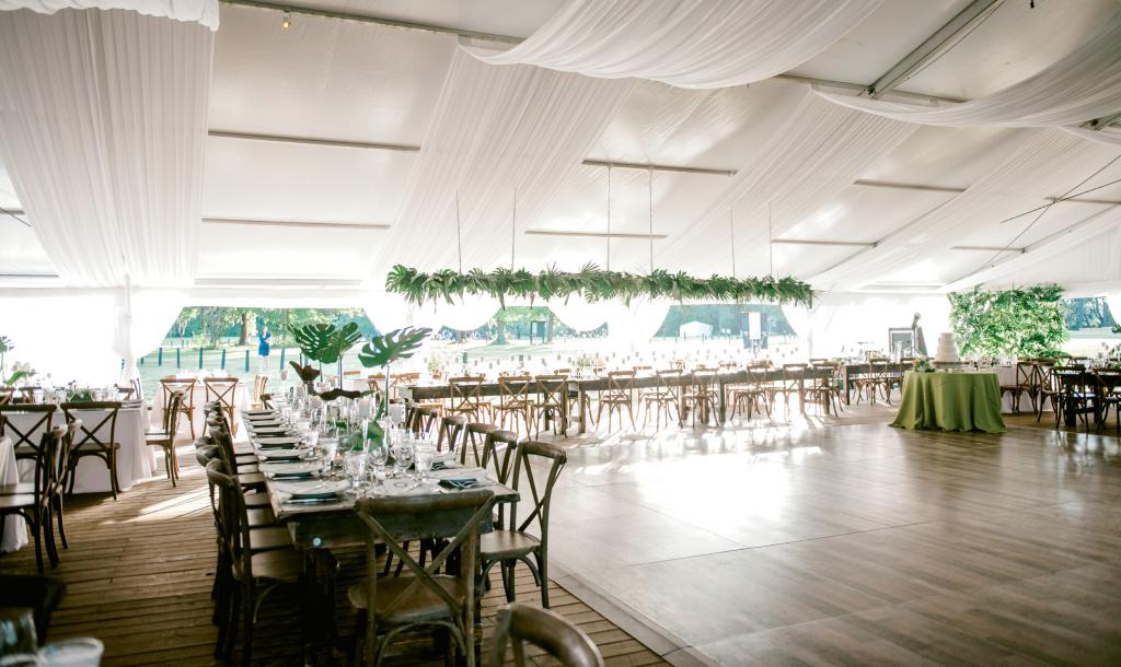"""The space, the design, and the feel were all my mom,"" says Lucy.  ""She has such an amazing eye and it was an incredible labor of love for her. She found the venue and a photo of a hanging greenery arrangement, and was off to the races."""