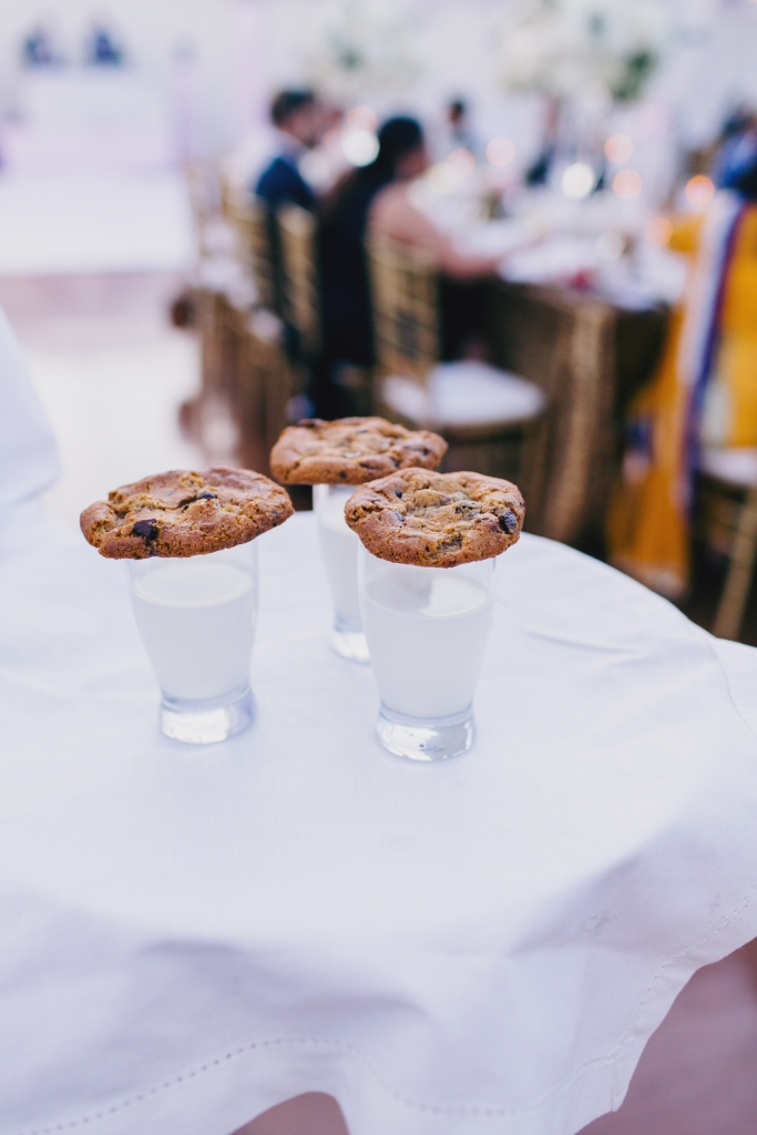 """Will and I are not dessert people,"" says Manasa. ""Instead of cutting a cake, we had a variety of Indian and American desserts in shooter sizes so people could try as many as they liked."" One such offering? Milk shots garnished with chocolate-chip cookies. <i>Photograph by Hyer Images</i>"