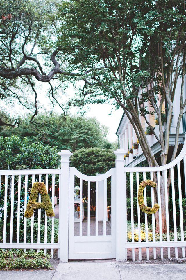 A TO C: Greens arranged in letter shapes hung from the gate, welcoming guests to the Governor Thomas Bennett House.