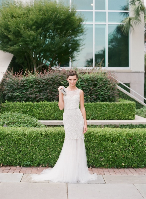 """Black Label by Anne Barge Collection's """"Bacall"""" gown available in Charleston through White on Daniel Island. Clara Kasavina's """"Samira"""" jeweled clutch from Gwynn's of Mount Pleasant. Image by Corbin Gurkin."""
