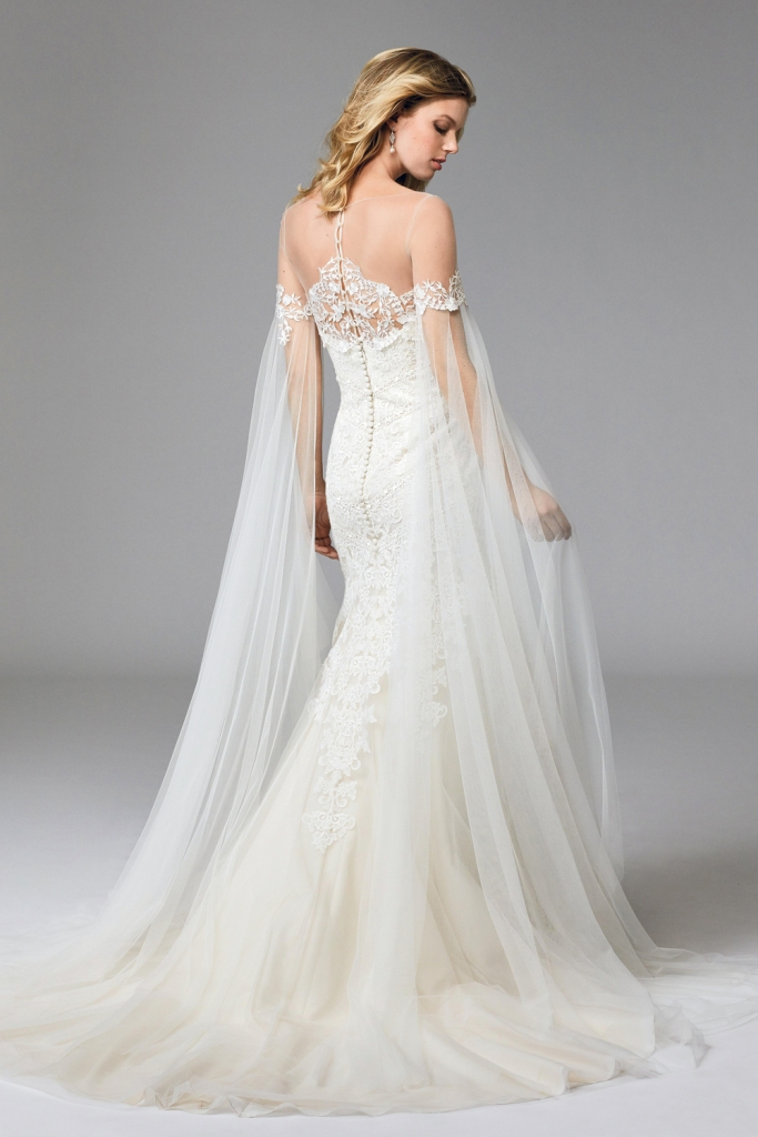 "TREND: Veiled sleeves LOOK: Wtoo's ""Ellie Cape,"" available in Charleston through Bridals by Jodi, Fabulous Frocks, and Lovely Bride"