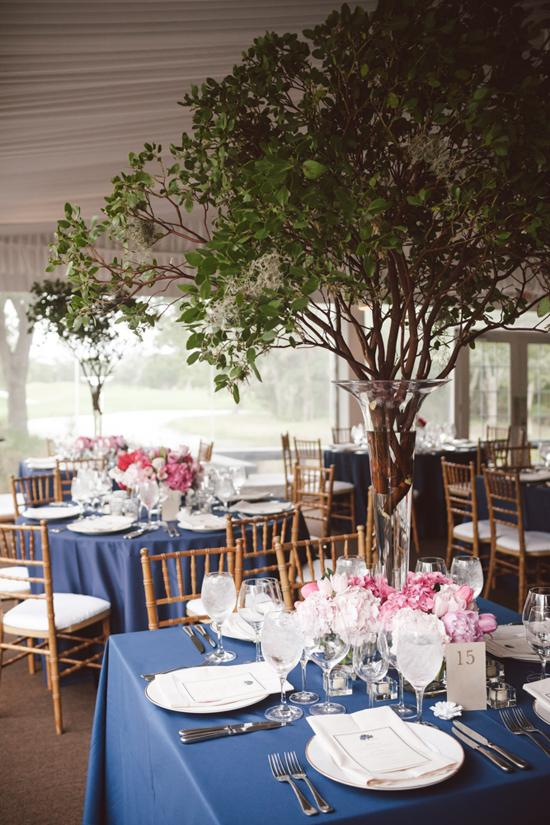 BRING THE OUTDOORS IN: Make a major statement with branches, like these draped with Spanish moss.