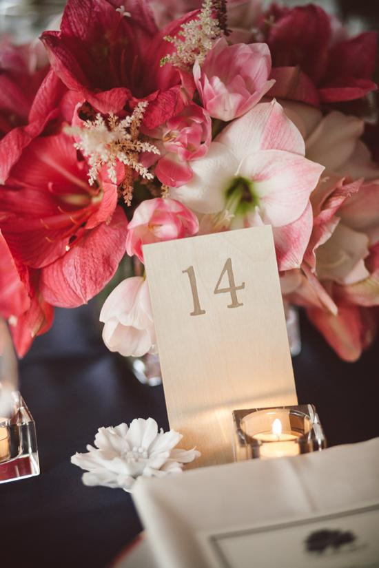 ALL ACCOUNTED FOR The table numbers were pressed into pieces of wood that were supported by white porcelain flowers.