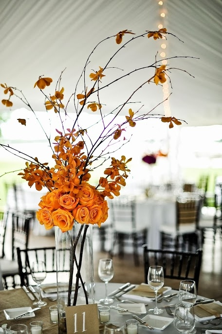 BOLD BUDS: Adding intrigue to the floral design, Judy Johnston mixed towering arrangements with daintier blooms throughout the reception.