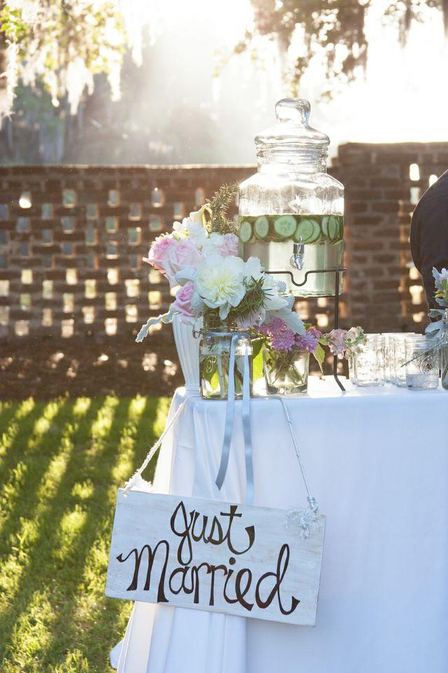THE DREAM TEAM: D'Anne tackled the visual details like this signage—creating 80 percent of the décor herself—while Patrick got the music, menu, and bar selections in order. The signature cocktail of the evening? Lowcountry lemonade served with blueberries and blue and white striped straws.