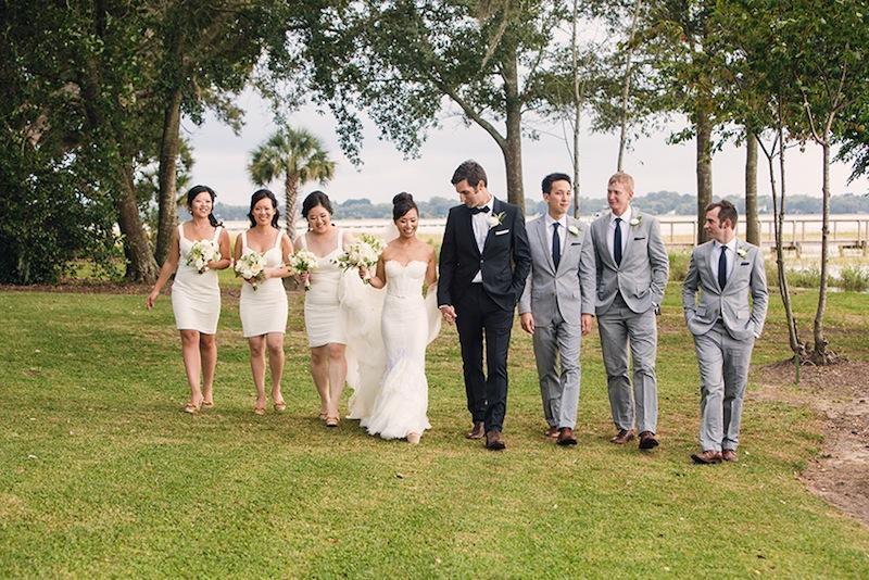 Bridal gown by Inbal Dror. Bridesmaid dresses by BCBGMAXAZRIA. Hair and makeup by Charlotte Belk. Groom's suit by Burberry. Groomsmen's suits and ties by J.Crew. Florals by Sara York Grimshaw Designs. Image by Virgil Bunao Photography at Lowndes Grove Plantation.