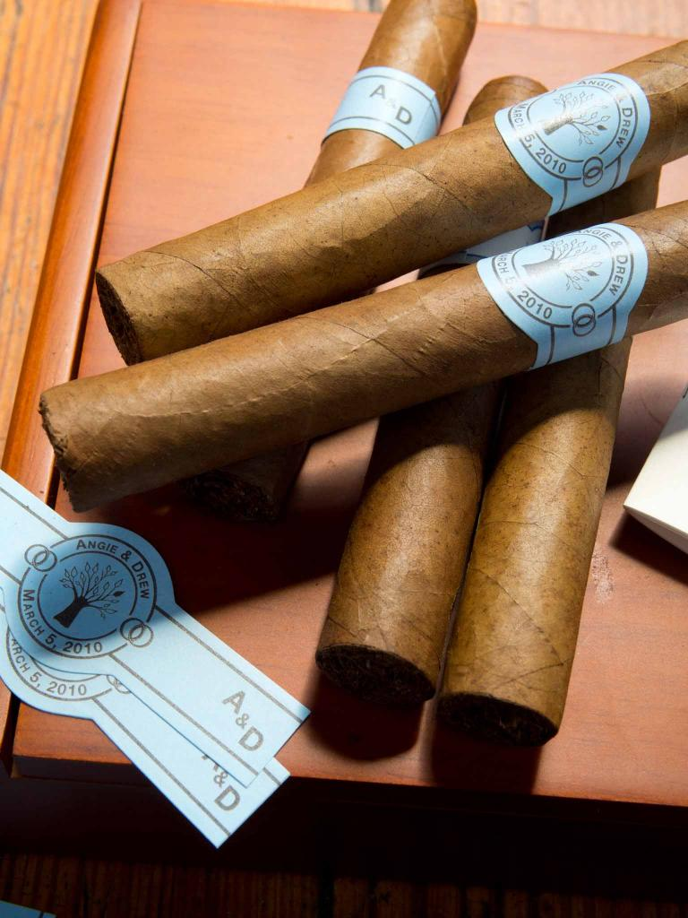 ON A ROLL: Hand-rolled cigars with custom bands from Coastal Cigars.