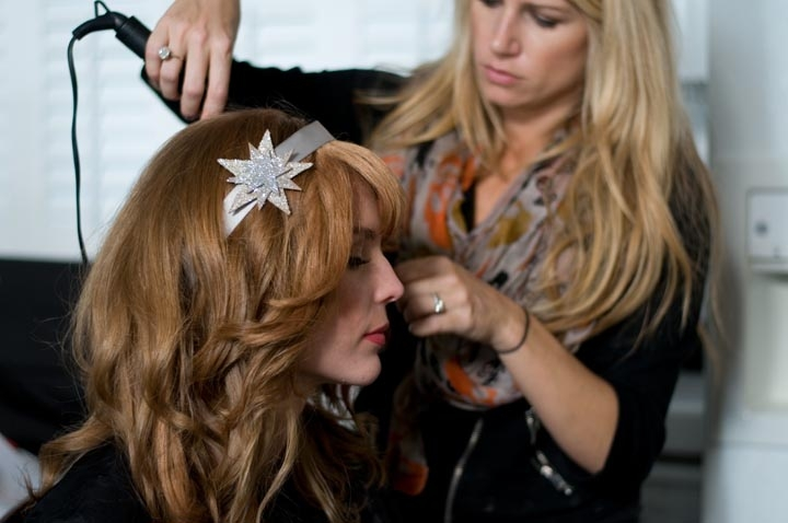 Hair and makeup artist Ashley Brooke Perryman gives Chelsea that tousled beach curl look to suit the setting. We commissioned Jessica Bauman of Onawa Designs to create the glittering stars that were used as belts, headbands, and hairpins. Photograph by Taylor Horton