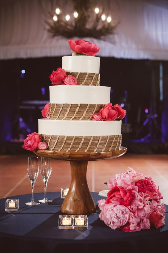SOUTHERN TREAT: The three-tiered wedding cake by Wedding Cakes by Jim Smeal featured sweetgrass detailing as a nod to the flower girls' baskets.