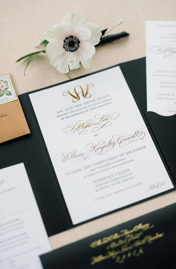 Charleston stationer Dodeline Design crafted an elaborate trifold invitation suite with a custom monogram, a weekend program, and more.