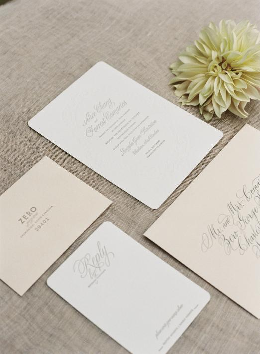 42 Pressed created a suite of classic stationery with swirling type and Elizabeth Porcher Jones calligraphed the envelopes.