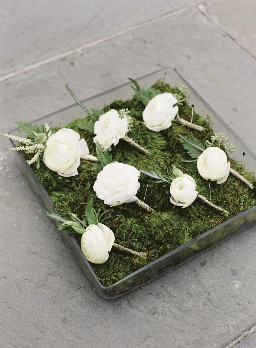 Sara York Grimshaw Designs crafted boutonnieres from ranunculus, astilbe, and fresh greens.