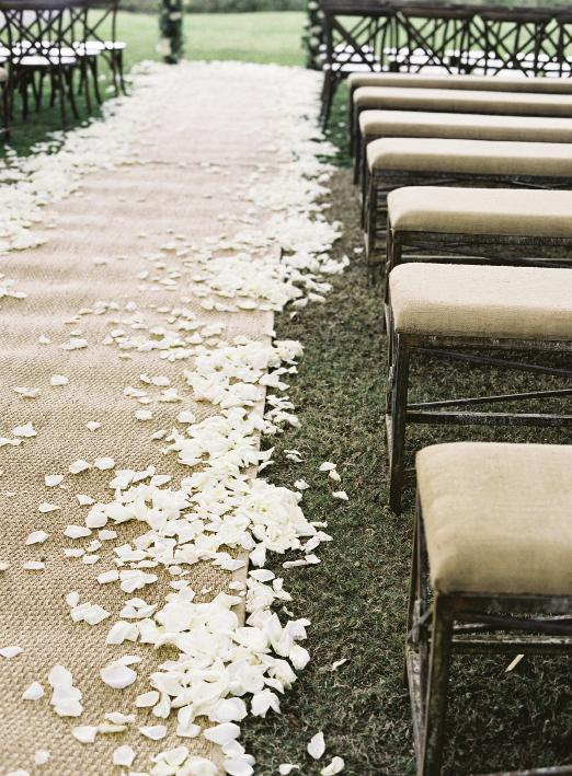 A shower of rose petals softens the border of any aisle runner, like this one of seagrass. Looking for something similar? GDC Home stocks samples that you can use for your ceremony... and in your new home.