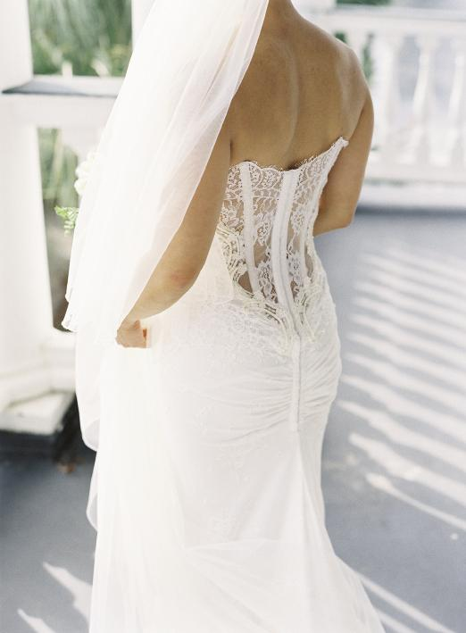 Alice's Inbal Dror gown featured the hautest trend in bridal wear: a low-cut back of illusion lace and corset boning. For a demure touch during the ceremony, she donned a trailing veil.